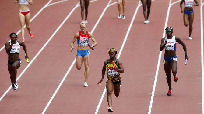 Fraser-Pryce leads the final leg to win her women's 4 x 100 metres relay heat at the 15th IAAF Championships in Beijing