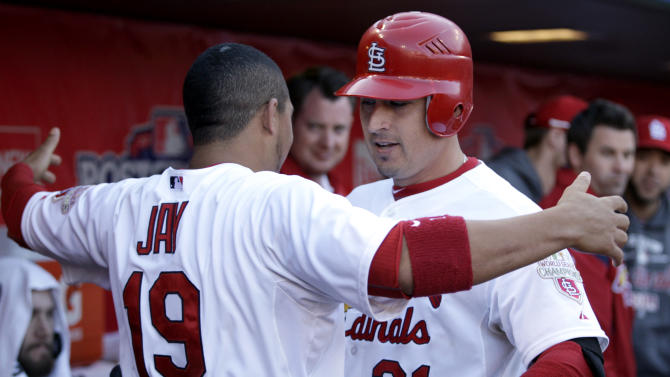 St. Louis Cardinals' Allen Craig, right, gets a hug from teammate Jon Jay after hitting a solo home run during the third inning in Game 2 of baseball's National League division series against the Washington Nationals, Monday, Oct. 8, 2012, in St. Louis.  (AP Photo/Tom Gannam)