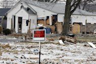 A severely damaged home is seen Tuesday, Feb. 5, 2013, in Union Beach, N.J. New Jersey Gov. Christie told a gathering in Union Beach Tuesday that the National Flood Insurance Program&#39;s handling of claims in New Jersey &quot;has stunk,&quot; complaining that the program has been far too slow to resolve claims from Superstorm Sandy, with 70 percent of cases unresolved three months after the disaster. (AP Photo/Mel Evans)