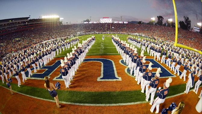 The Auburn band takes the field before the NCAA BCS National Championship college football game against Florida State Monday, Jan. 6, 2014, in Pasadena, Calif. (AP Photo/Mark J. Terrill)