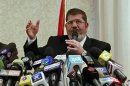 Presidential candidate Mursi speaks during a news conference in Cairo