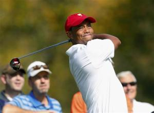 U.S. team member Tiger Woods hits off the third tee during the first practice round for the 2013 Presidents Cup golf tournament at Muirfield Village Golf Club in Dublin, Ohio