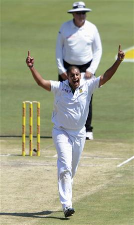 South Africa's Rory Kleinveldt celebrates after taking the wicket of Pakistan's Asad Shafiq during the third day of the third cricket Test match in Pretoria