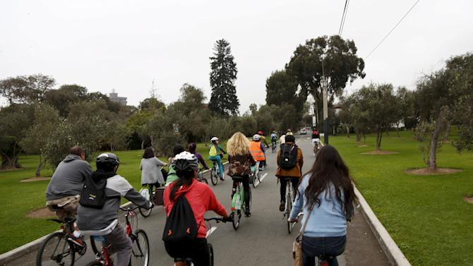 Spanish singer Christina Rosenvinge participates in a bike ride with bicycle activists in Miraflores, Lima, Peru