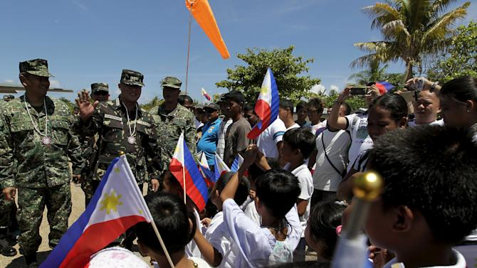 waves as residents welcome him during his visit at Pagasa island