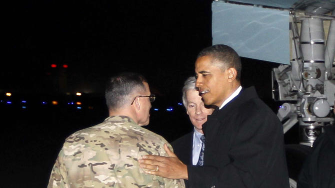 """President Barack Obama is greeted by Lt. Gen. Curtis """"Mike"""" Scaparrotti, and U.S. Ambassador to Afghanistan Ryan Crocker as he steps off Air Force One at Bagram Air Field in Afghanistan, Tuesday, May 1, 2012. (AP Photo/Charles Dharapak)"""