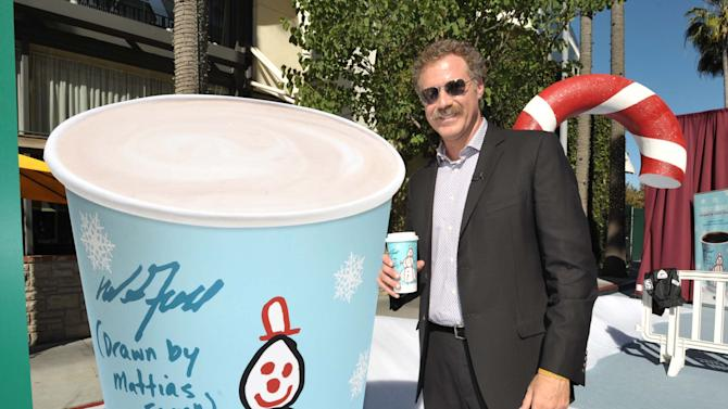 IMAGE DISTRIBUTED FOR 7-ELEVEN - Will Ferrell poses next to 7-Eleven's Holiday Cup designed by his son at The Grove, on Tuesday, Nov. 13, 2012 in Los Angeles. (Photo by John Shearer/Invision for 7-Eleven/AP Images)