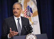 US Attorney General Eric Holder speaks on February 20, 2013 at the Eisenhower Executive Office Building in Washington, DC. The US government vowed to aggressively combat a rise in the foreign theft of trade secrets amid mounting concerns over recent hacking attacks allegedly emanating from China