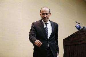 Syrian opposition leader Jarba leaves a news conference in Geneva