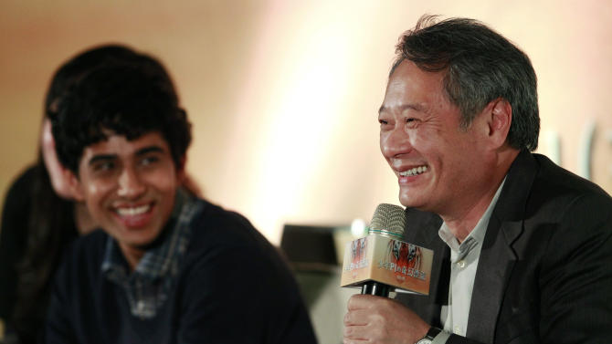 """Lead actor from India Suraj Sharma, left, looks on, as Taiwanese director Ang Lee answers questions during a press conference announcing their new film """"Life of Pi,"""" in Taipei, Taiwan, Wednesday, Nov. 7, 2012. """"Life of Pi"""" is an upcoming 3D adventure film based on the 2001 novel of the same name by Yann Martel, staring Sharma and directed by Lee. (AP Photo/Wally Santana)"""
