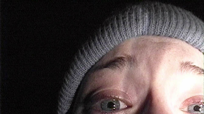 """FILE - in this publicity file photo provided by Artisan Entertainment, Heather Donahue turns the camera on herself during her confession scene from the horror film """"The Blair Witch Project."""" (AP Photo/Artisan Entertainment, file)"""