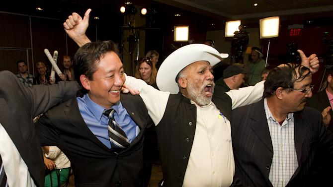 Wildrose MLA Tany Yao celebrates winning his riding with supporters at the Wildrose election room in Fort McMurray