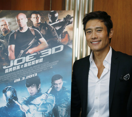 FILE - In this Dec. 12, 2012 file photo, South Korea actor Lee Byung-hun poses for photographers after an interview for his latest film &quot;G.I. Joe: Retaliation&quot; in Hong Kong. Lee says he had to train hard to do justice to his character in G.I. Joe: Retaliation. The upcoming sequel to &quot;G.I. Joe: The Rise of Cobra&quot; has Storm Shadow rising from the dead and out for vengeance. And it required the South Korean actor develop a stronger build. (AP Photo/Kin Cheung, File)