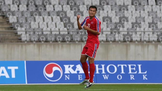 North Korea's So Kyong-jin celebrates after scoring a goal during their men's first round Group F soccer match against Pakistan at the 17th Asian Games in Hwaseong, South Korea, Thursday, Sept. 18, 2014