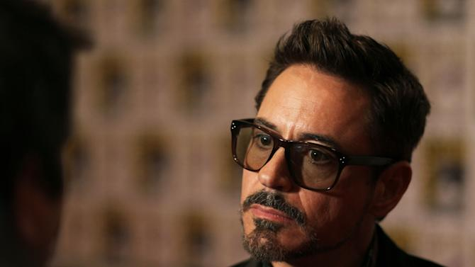"""Robert Downey Jr. attends the press line for """"Iron Man 3"""" during Comic-Con, Saturday, July 14, 2012, in San Diego. (Photo by Matt Sayles/Invision/AP)"""