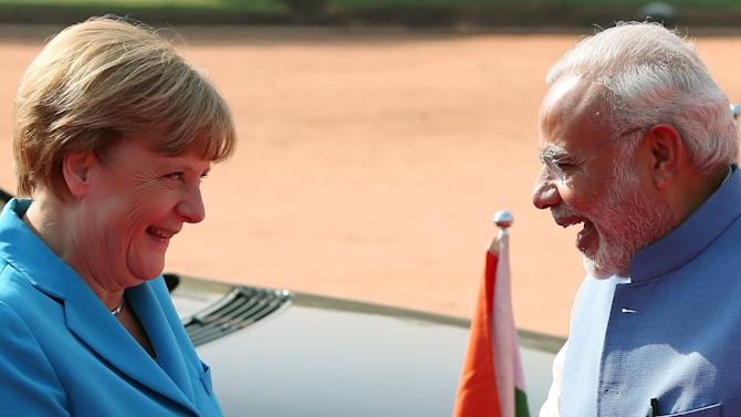 German Chancellor Merkel and Indian Prime Minister Modi share a moment during Merkel's ceremonial reception at the forecourt of India's Rashtrapati Bhavan presidential palace in New Delhi