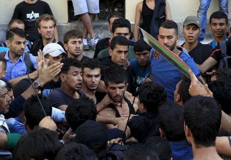 A group of migrants try to make their way through the crowd to the Keleti Railway Terminus in Budapest