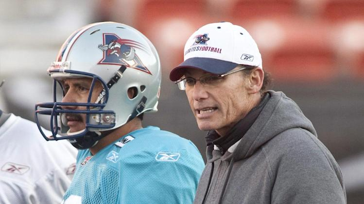 CORRECTS MARK TO MARC In this Nov. 26, 2010 photo,Montreal Alouettes head coach Marc Trestman, right, and quarterback Anthony Calvillo watch a practice session in Edmonton. The Bears hired Trestman on Wednesday, Jan. 16, 2013,  to replace the fired Lovie Smith, hoping he can get the most out of quarterback Jay Cutler and make Chicago a playoff team on a consistent basis.  (AP Photo/The Canadian Press, Adrian Wyld)