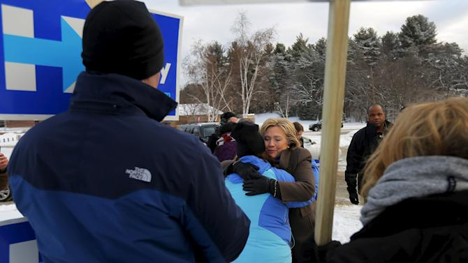 U.S. Democratic presidential candidate Hillary Clinton hugs a supporter outside a polling place in Nashua