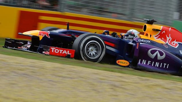 Red Bull driver Sebastian Vettel of Germany powers out of a corner at the Formula One Australian Grand Prix in Melbourne on March 16, 2013 (AFP)