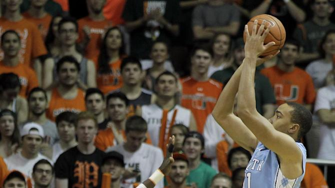 North Carolina's Brice Johnson, right, shoots the ball over Miami's Tonye Jekiri (23) during the first half of an NCAA college basketball game, Saturday, Feb. 28, 2015, in Coral Gables, Fla. (AP Photo/Luis M. Alvarez)