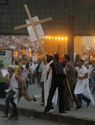 Clashes erupt at a protest of a recent attack on a church in Cairo Egypt, Sunday, Oct. 9, 2011. Fierce clashes erupted Sunday between Christians protesting a recent attack on a church and the Egyptian military, leaving more than a dozen people dead and scores injured, Health Ministry officials said. (AP Photo/Ahmed Ali)