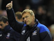 Everton manager David Moyes, pictured in May 2012, insisted on Saturday that he was happy at Goodison Park despite speculation linking him with a switch to Tottenham as Harry Redknapp&#39;s replacement