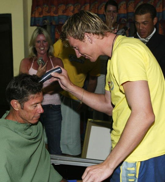 John Buchanan coach of Australia has his head shaved by Brett Lee of Australia