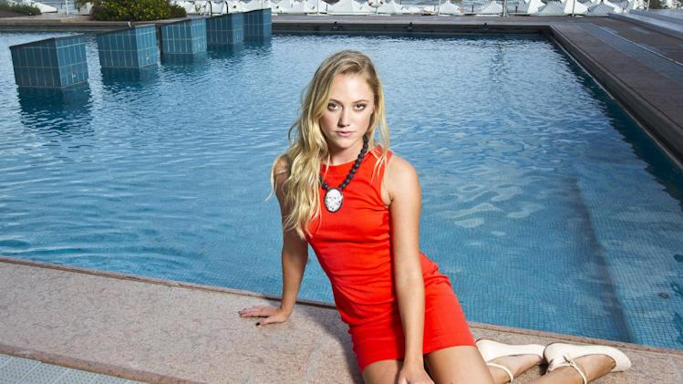 Actress Maika Monroe poses for portraits  to promote the film 'At Any Price' during the 69th edition of the Venice Film Festival in Venice, Italy, Friday, Aug. 31, 2012. (AP Photo/Joel Ryan)