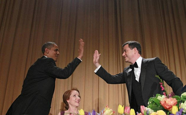 President Barack Obama high-fives late-night comic Jimmy Kimmel as Caren Bohan, a Reuters journalist and president of the White House Correspondents' Association looks on during the White House Co