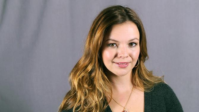 """This Sept. 18, 2013 photo shows actress Amber Tamblyn in New York. Tamblyn will guest star as Charlie Harper's daughter in the upcoming season of the comedy series """"Two and a Half Men,"""" premiering Thursday, Sept 26 at 9:30 p.m. on CBS. (Photo by Diane Bondareff/Invision/AP)"""