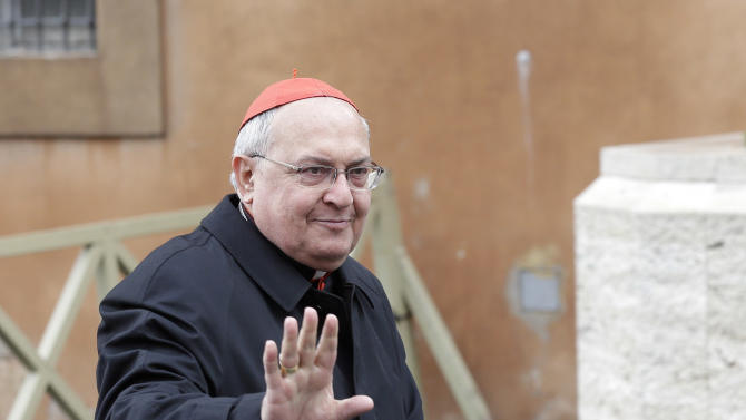 Argentine Cardinal Leonardo Sandri waves as he arrives for a meeting at the Vatican, Monday March 11, 2013.  Cardinals have gathered for their final day of talks before the conclave to elect the next pope amid debate over whether the Catholic Church needs a manager pope to clean up the Vatican's messy bureaucracy or a pastoral pope who can inspire the faithful and make Catholicism relevant again. (AP Photo/Alessandra Tarantino)