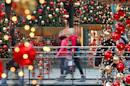 Christmas shoppers make their way through a shopping mall in the western German city of Oberhausen on December 22, 2010. German shoppers cut back their spending sharply in September 2014, raising eurozone economy fears