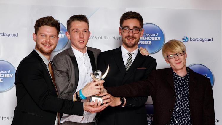 """FILE - This Nov. 1, 2012 file photo shows members of Alt-J, from left,  Joe Newman,  Thom Green, Gus Unger-Hamilton and Gwil Sainsbury at the Barclaycard Mercury Prize Albums of the Year awards 2012 at the Camden Roundhouse in London.  Their debut album, """"An Awesome Wave,"""" went on to win the prestigious Mercury Prize given to the top album of the year in the United Kingdom and Ireland. The Cambridge quartet has since been a near constant conversation piece on the blogosphere and mid-sized club circuit on both sides of the Atlantic Ocean. (Photo by John Marshall JME/Invision/AP)"""