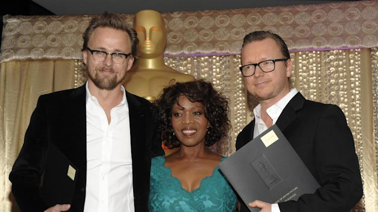 """From left to right, director Joachim Roenning, actress Alfre Woodard and director Espen Sandberg pose together during the The Oscars Foreign Language Film Award Directors Reception at The Academy of Motion Picture Arts and Sciences in Beverly Hills, Calif. on Friday, Feb. 22, 2013. Roenning and Sandberg's feature film """"Kon-Tiki"""" is nominated for Best Foreign Language Film. (Photo by Dan Steinberg/Invision/AP)"""
