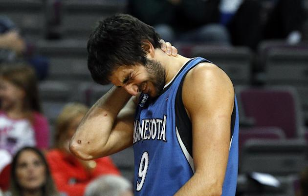 Minnesota Timberwolves guard Ricky Rubio (9), of Spain, reacts on his way to the bench after being hit in the second half of their preseason NBA basketball game against the Detroit Pistons in Auburn H