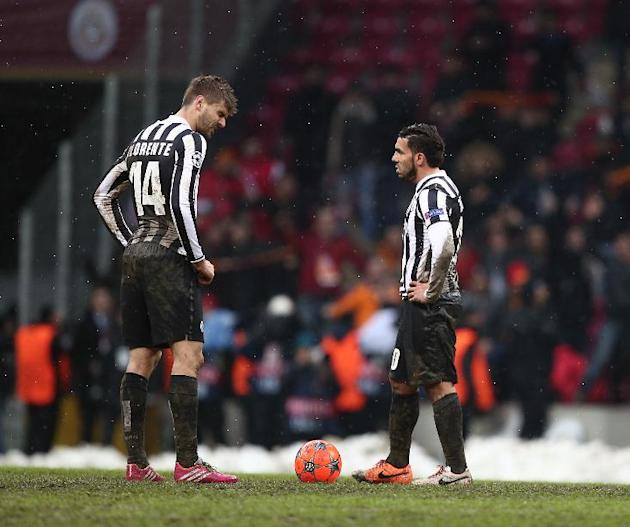 Juventus players react after losing their Champions League soccer match against Galatasaray at the TT Arena Stadium in Istanbul, Turkey, Wednesday, Dec. 11, 2013. The match was halted Tuesday in the 3