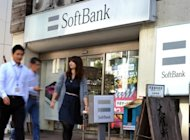 "<p>Pedestrians pass a Softbank shop in Tokyo. Softbank's tie-up with Sprint ""will provide Sprint with capital that the company needs to better compete with its larger rivals,"" said analyst Thomas Seitz at Jefferies.</p>"
