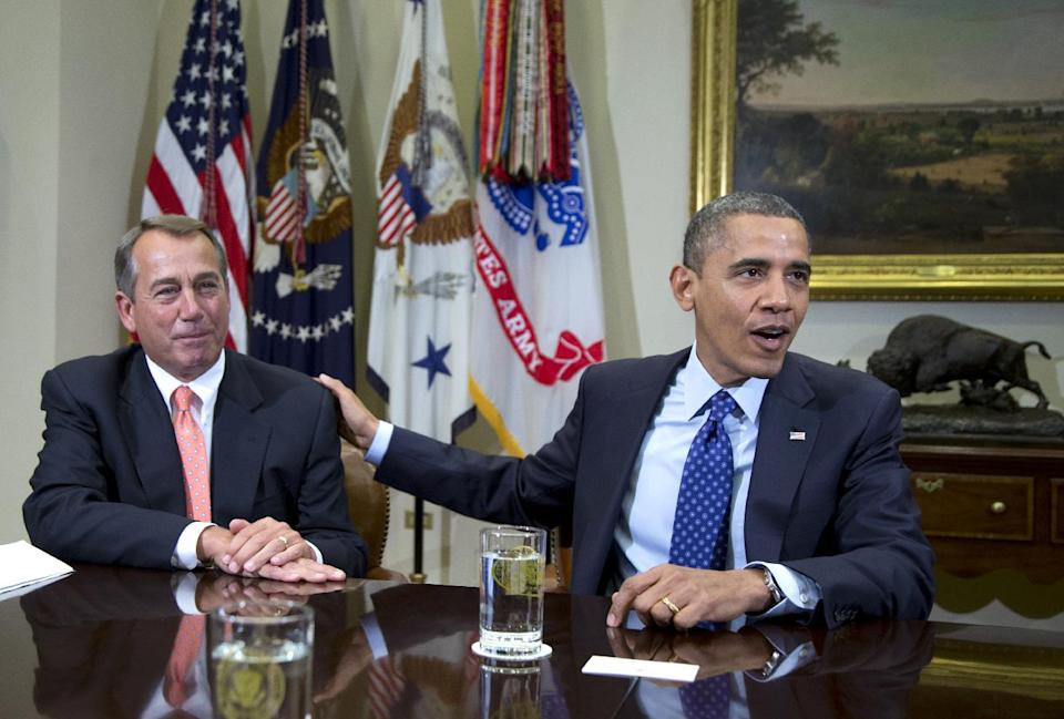 President Barack Obama acknowledges House Speaker John Boehner of Ohio while speaking to reporters in the Roosevelt Room of the White House in Washington, Friday, Nov. 16, 2012, as he hosted a meeting of the bipartisan, bicameral leadership of Congress to discuss the deficit and economy. (AP Photo/Carolyn Kaster)