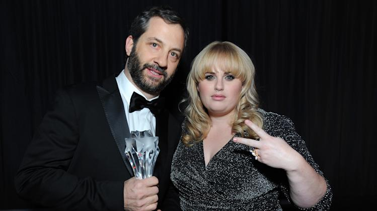 IMAGE DISTRIBUTED FOR LOUIS XIII - Judd Apatow toasts his Critics' Choice LOUIS XIII Genius Award with Rebel Wilson at the Critcs' Choice Movie Awards at Barker Hangar on Thursday, January 10, 2013 in Santa Monica, Calif.