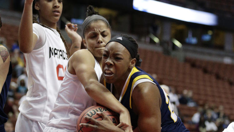 UC Irvine's Camille Buckley, right, and Cal State Northridge's Ashlee Guay fight for the ball during the first half of an NCAA college basketball game in the semifinals of the Big West Conference tournament Friday, March 14, 2014, in Anaheim, Calif. (AP Photo/Jae C. Hong)