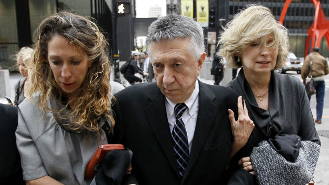 "William Cellini, center, departs the federal courthouse with unidentified family members after Judge James Zagel sentenced him to 366 days in prison and a $75,000 fine Thursday, Oct. 4, 2012, in Chicago. Cellini, 77, was convicted last year for his role in trying to get a $1.5 million campaign contribution for former Gov. Rod Blagojevich from the Oscar-winning producer of ""Million Dollar Baby"" in exchange for state business.  (AP Photo/Charles Rex Arbogast)"