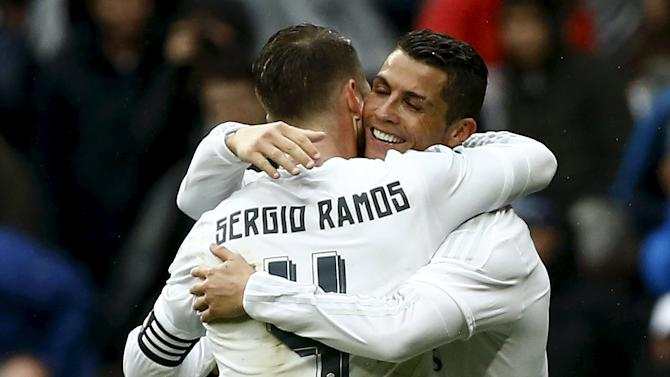 Real Madrid's Cristiano Ronaldo celebrates his second goal with teammate Sergio Ramos