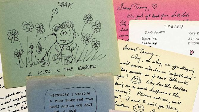 CORRECTS SPELLING OF SCHULZ, NOT SCHULTZ - This photo provided by Sotheby's in New York shows some of the romantic letters and drawings the late Peanuts creator Charles Schulz sent to a young woman 23 years his junior, who infatuated him. The love notes from 1970-1971 are being offered for sale at Sotheby's in New York by the family of Tracey Claudius, who the auction house says is ill at her home near Philadelphia. It's estimated they'll bring $250,000 to $350,000 at the Dec. 14 auction. (AP Photo/Sotheby's)