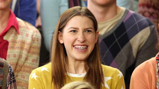 "This undated publicity image released by ABC shows actress Eden Sher as Sue Heck in a scene from the comedy series ""The Middle,"" airing Wednesday at 8 p.m. EST on ABC. Sher wore a set of removable braces to her audition to play the daughter on the ABC comedy, helping her win the job. They're the signature of the geeky, loveable loser that is high school soph Sue Heck. (AP Photo/ABC, Michael Ansell)"