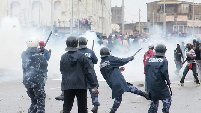 Security forces fire tear gas as they clash with anti-government protesters in Lome, Togo Tuesday, June 12, 2012. More than 10,000 protesters took to the streets of Togo's capital Tuesday to protest recent changes to the electoral code and to express their frustration over the government's failure to act to address long-standing grievances such as human rights violations by security forces. (AP Photo/Erick Kaglan)