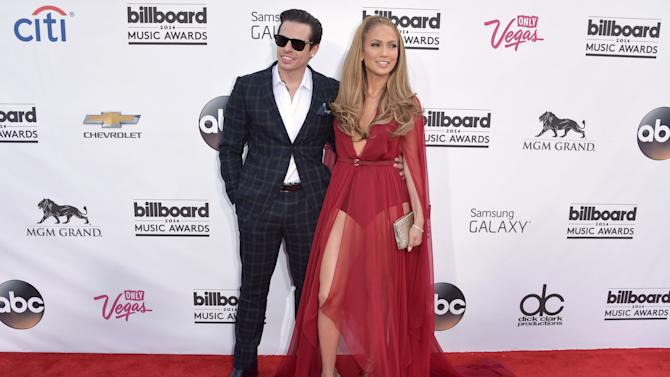 Casper Smart, left, and Jennifer Lopez arrive at the Billboard Music Awards at the MGM Grand Garden Arena on Sunday, May 18, 2014, in Las Vegas. (Photo by John Shearer/Invision/AP)