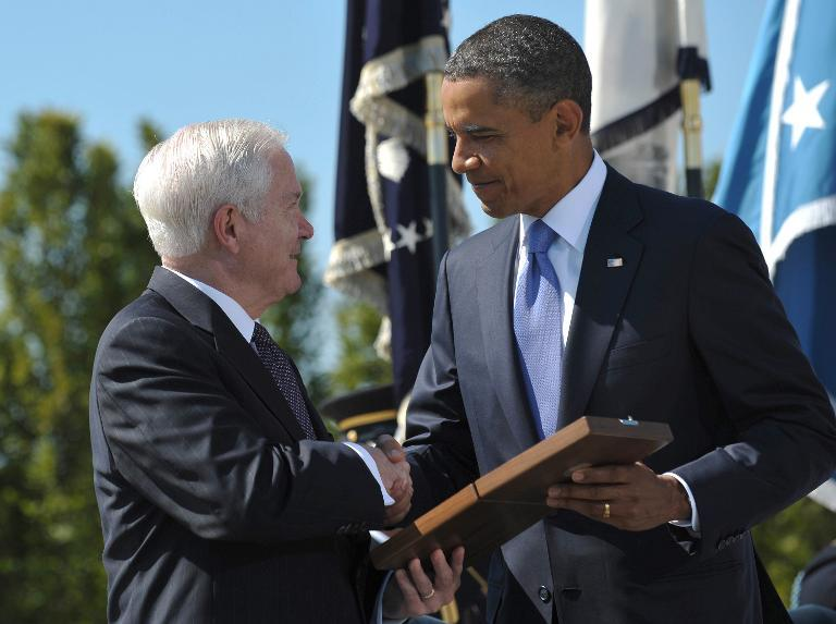 US President Barack Obama presents the Medal of Freedom to outgoing defense secretary Robert Gates, June 30, 2011, at the Pentagon in Washington, DC