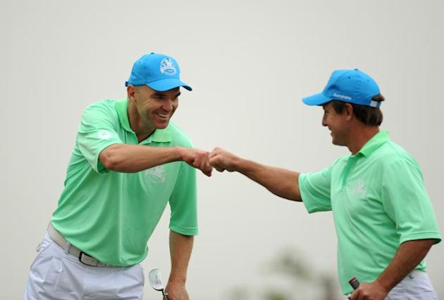 This handout photo taken and released on December 13, 2013 by OneAsia shows golfers Michael Long (L) and Scott Laycock of Asia Pacific Select team during the fourball matches at the Dongfeng Nissan Cu