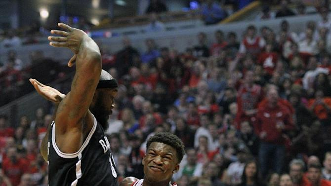 Chicago Bulls' Jimmy Butler drives to the basket against Brooklyn Nets' Reggie Evans during the first half of an NBA basketball game Saturday, April 27, 2013, in Chicago. (AP Photo/Jim Prisching)
